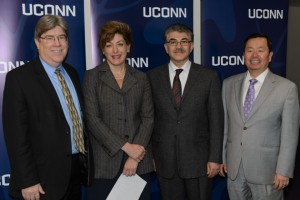 J. Michael McQuade, UTC senior vice president of science and technology, left, President Susan Herbst, Kazem Kazerounian, interim dean of engineering, and Provost Mun Choi announced the launch of the UTC Institute for Advanced Systems Engineering at UConn.