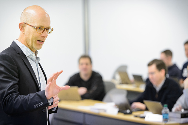 Timothy Folta, professor of management, leads a class at the Graduate Business Learning Center in Hartford on Dec. 6, 2013. (Peter Morenus/UConn Photo)
