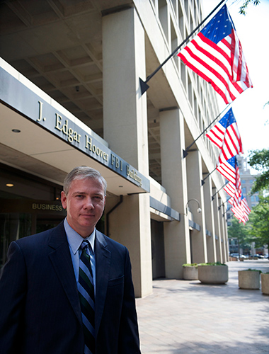 Jim Trainor '93 MPA, deputy assistant director, FBI Cyber Division, in front of the J. Edgar Hoover FBI Building, headquarters of the FBI, in Washington, D.C. (Photo courtesy of the FBI)