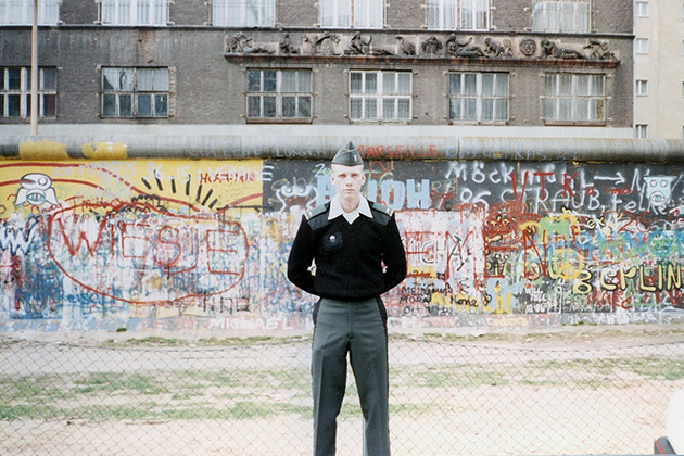 Jim Trainor '93 MPA stands in front of the Berlin Wall in Germany in 1988.