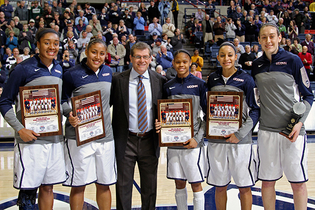Five Huskies were recognized for their USA Basketball accomplishments before the women's basketball team's 90-40 win over Houston at Gampel Pavilion on Tuesday. Above, from left: Morgan Tuck '16 (CLAS, Kaleena Mosqueda-Lewis '15 (CLAS), head coach Geno Auriemma, Moriah Jefferson '16 (CLAS), Bria Hartley '14 (CLAS) and Breanna Stewart '16 (CLAS). (Bob Stowell '70 (CLAS) for UConn)