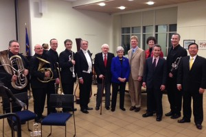 Atlantic Quintet members, from left, John Manning, Seth Orgel, Tim Albright, Andrew Sorg, conductor Jeffrey Renshaw, philanthropists Raymond and Beverly Sackler, composer Kevin Walczyk, his wife Elizabeth, department head Eric Rice, Atlantic Quintet member and UConn music professor Louis Hanzlik, and Provost Mun Choi at the Stamford Campus. (UConn Photo)