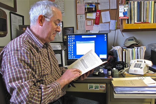 Steve Olsen '85 (CANR) has both electronic data and historic paper records available for reference in his office. (Sheila Foran/UConn Photo)