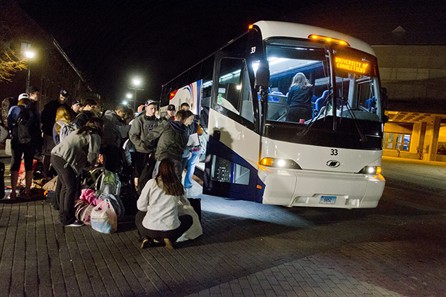 Students board a bus from Storrs to Arlington, Texas for the Final Four this weekend on Oct. 8, 2013. (Ariel Dowski/UConn Photo)