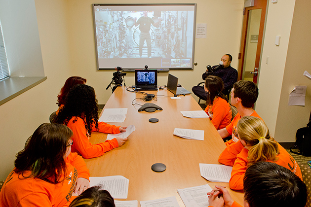 A group of engineering students and faculty discuss questions over video chat with astronaut Rick Mastracchio '82 (ENG) from the Charles B. Gentry Building on April 18, 2014. (Ariel Dowski '14 (CLAS)/UConn Photo)