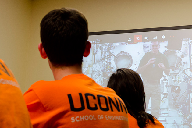 A group of engineering students discussed questions with astronaut Rick Mastracchio '82 (ENG) at the International Space Station during a live video chat from the Charles B. Gentry Building on April 18. (Ariel Dowski '14 (CLAS)/UConn Photo)