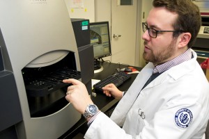 Ph.D. Candidate David Drew uses a laser capture microdissection instrument to isolate aberrant colon cells to investigate the earliest initiating events leading to colon cancer. March 6, 2014. (Tina Encarnacion/UConn Health Photo)