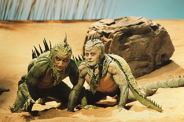 """Actors wearing the lizard costumes from """"Seascape,"""" part of the 'Stagecraft' Exhibition at The William Benton Museum of Art. (T.Charles Erickson Photo)"""