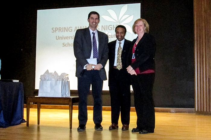 From left, Loeser award recipient, Dr. Jason Ryan with Dr. David Henderson, associate dean for student affairs, and Christine Thatcher, director of medical education. (Photo provided by Roselyn Wright)