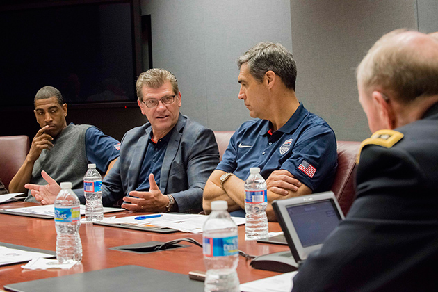 Geno Auriemma, UConn women's basketball head coach, talks with 18th Chairman of the Joint Chiefs of Staff Army Gen. Martin E. Dempsey, right, during a Sports Leadership Seminar at the Pentagon in May 2014. Dempsey will headline the Auriemma UConn Leadership Conference in October. (Army Staff Sgt. Sean K. Harp/Department of Defense Photo)