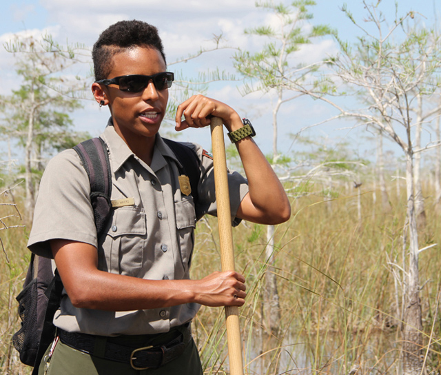 "Bleu Waters, a ranger at Ever­glades National Park, leads a ""wet hike"" so that vis­i­tors can dis­cover the true Ever­glades. (Kait­lyn Carroll/UConn Photo)"