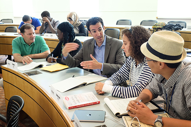 Roy Pietro, director of UConn's Global Training and Development Institute (left), and Chad Turner, co-founder of Go Media (center), speak to students from North and Sub-Sahara Africa at a workshop on using the Internet. The students are among 40 participants in a five-week U.S. State Department funded program being hosted by UConn, to deepen their understanding of the USA while equipping them with social entrepreneurial skills to create sustainable solutions to problems in their communities and countries. The students, from left to right, are: Sofie Camara (Senegal); Rafika Mokhtari (Algeria); and Sohayeb Belguith (Tunisia). (Peter Morenus/UConn Photo)