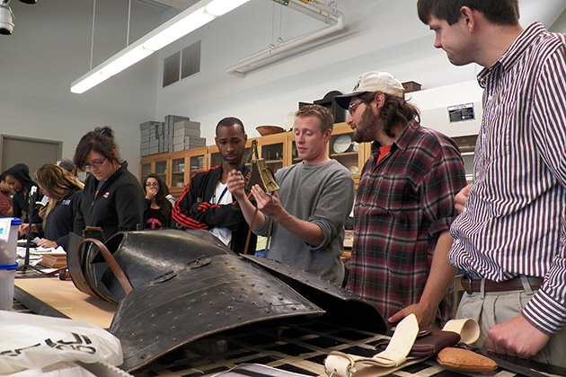 UConn Battlefield Archaeology Field School students ('13) learn about 17th century material culture, domestic and military, at the Mashantucket Pequot Museum & Research Center laboratory. Every summer, the UConn anthropology department and the museum offer archaeological field schools for students to gain valuable experience in the field. (Mashantucket Pequot Museum & Research Center Photo)