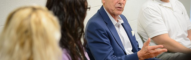 Alex Gitterman, professor of social work, meets with graduate students at the School of Social Work on Aug. 28, 2014. (Peter Morenus/UConn Photo)