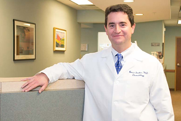 Dr. Bruce Strober, associate professor and vice chair of the Department of Dermatology at UConn Health, pictured in the dermatology clinical offices in Farmington. (Tina Encarnacion/UConn Health Photo)