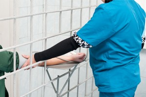 A nurse takes a patient's blood pressure in prison. (Shutterstock Photo)