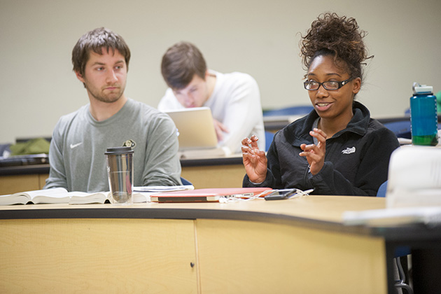 Students in a winter term class on the short story, on Jan. 13, 2015. (Sean Flynn/UConn Photo)