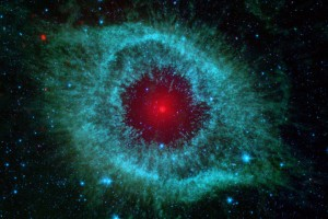 This infraredimage from NASA's Spitzer Space Telescope shows the H elix nebula, a cosmic starlet often protographed by amateur astronomers for its vivid colors and eerie resemblance to a giant eye. (NASAA/JPL-Caltech/Univ. of Arizona)