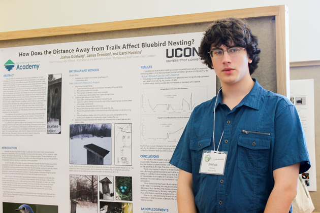 Joshua Goldwag, a junior at Nonnewaug High School, presents his study of bluebird habitat, at the Natural Resources Conservation Academy poster session in March. (Sheila Foran/UConn Photo)