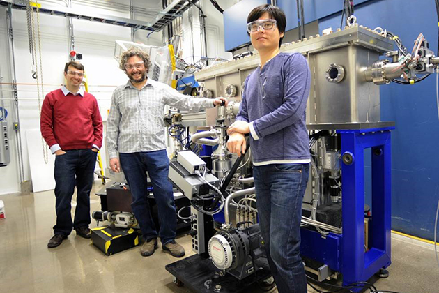 From left, Jason Hancock, assistant professor of physics, Diego Casa, and Jung-ho Kim, with one of the instruments used in the experiment. (Argonne National Laboratory Photo)