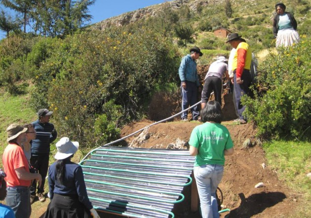 Each of the students pitched in and carried large pieces of wood, water barrels, and corrugated metal up the side of the mountain to the designated homes.