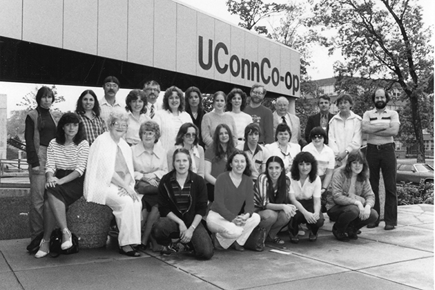 A 1983 photograph of the 2nd Co-op building which opened on Fairfield Way in 1980. Suzy Staubach is standing at far left.