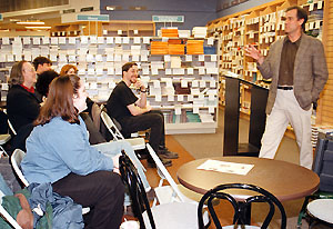 English professor Sam Pickering leads a discussion on Living to Prowl during a book reading at the Co-op in 1998.  PHOTO BY DAVID RUDDY 021898B12