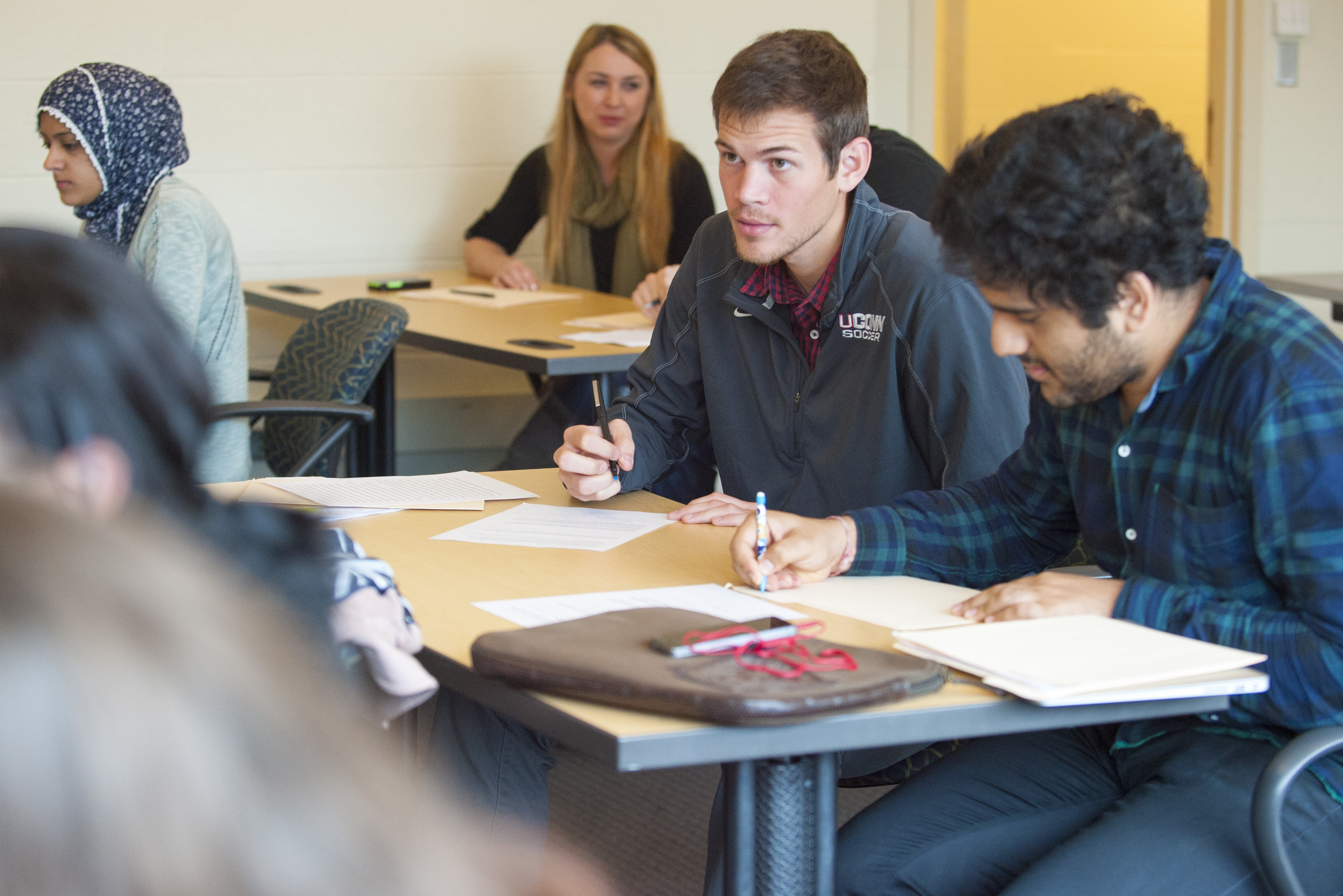 Student-athlete Istvan Kanyo, a walk-on defense player on the men's soccer team, in class on Nov. 18, 2015. (Sean Flynn/UConn Photo)