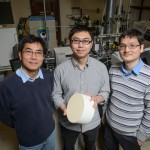 Industry mentor Wen Fu, left, Yanbing Guo, and Pu-Xian Gao in a lab at the Institute of Materials Science with a sample of the catalyst they have developed. (Peter Morenus/UConn Photo)