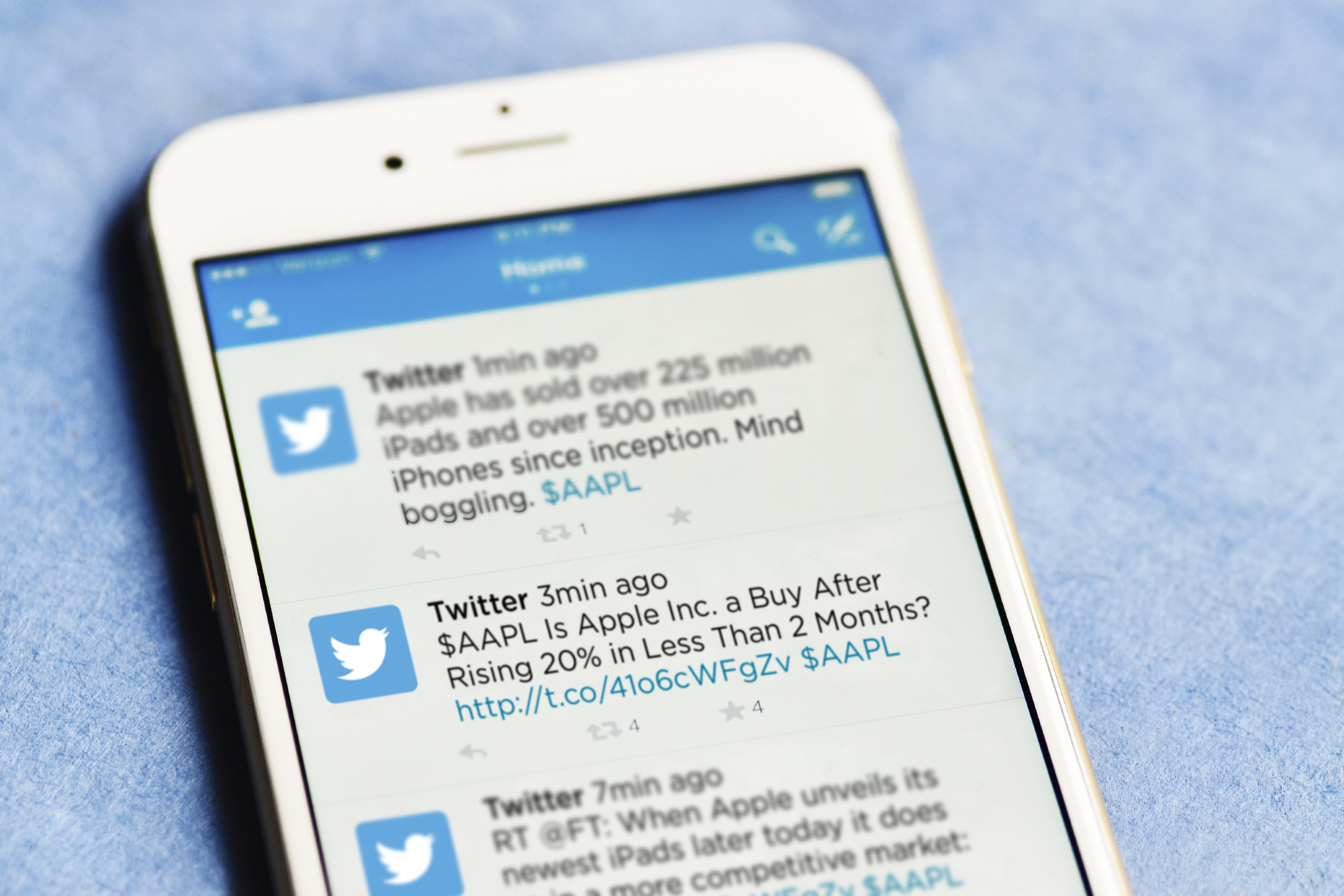 Business-related tweets on a smartphone. (Sean Flynn/UConn Photo)