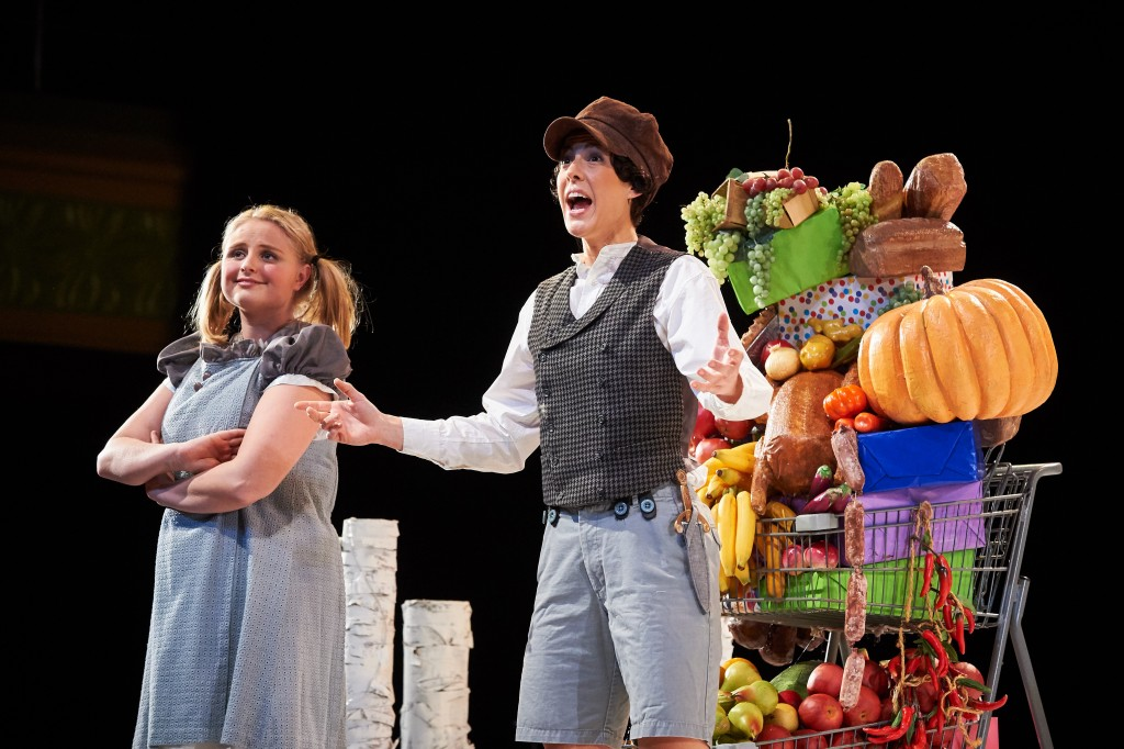 Katelyn Lewis '15 (SFA) as Gretel and Caroline O'Dwyer '11 (SFA) as Hansel stumble uponshopping carts filled with candy, fruit, and junk food. (Peter Morenus/UConn Photo)