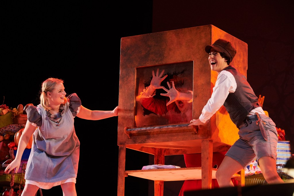 """A dress rehearsal for UConn Opera's presentation of """"Hansel and Gretel"""" at the Jorgensen Center for the Performing Arts on Jan. 27, 2016 with Caroline O'Dwyer '11 (SFA) as Hansel, Katelyn Lewis '15 (SFA) as Gretel and Spencer Hamlin '13 (SFA) as the witch. (Peter Morenus/UConn Photo)"""