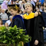 President Susan Herbst reads the citation to award Robert J. Schiller an honorary degree during the School of Business Commencement ceremony at Gampel Pavilion on May 10, 2015. (Peter Morenus/UConn Photo)