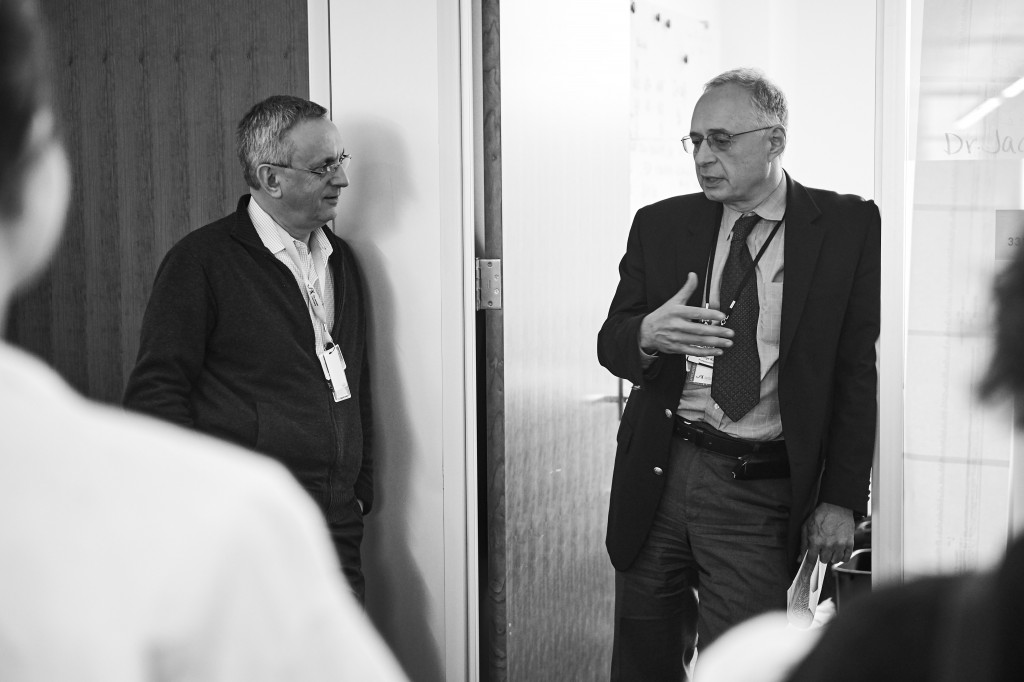 Jacques Banchereau, left, and George Kuchel, professor of medicine, speak with journalists visiting The Jackson Laboratory at UConn Health in Farmington on March 15, 2016. (Peter Morenus/UConn Photo)