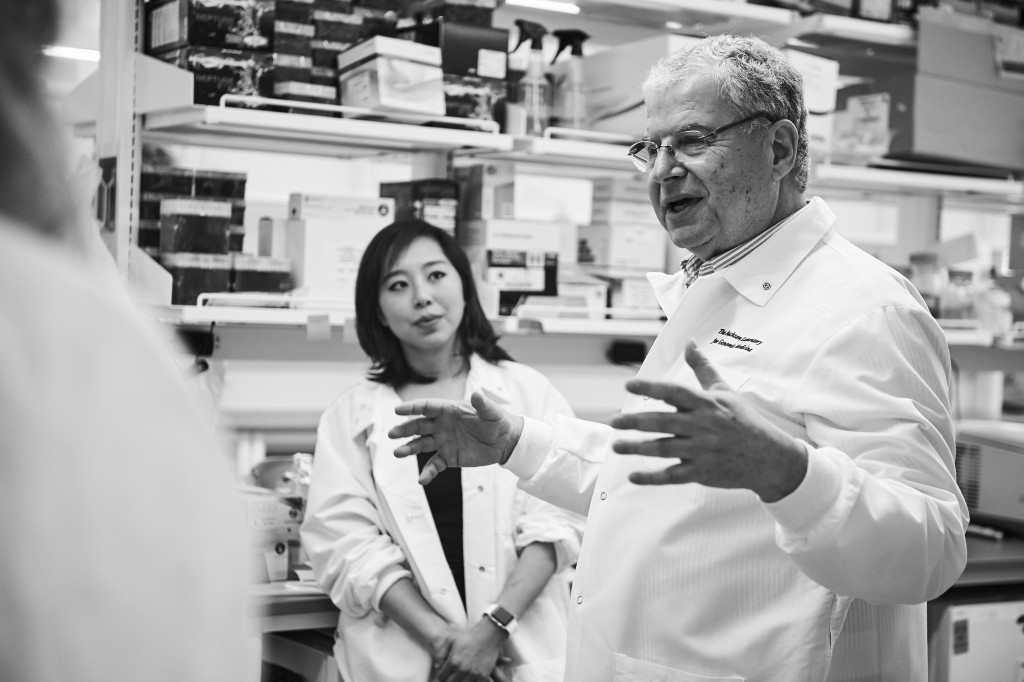 George Weinstock, Evnin family chair and director of microbial genetics, right, and Julia Oh, assistant professor of genetics and genome sciences, speak with journalists visiting The Jackson Laboratory at UConn Health in Farmington on March 15, 2016. (Peter Morenus/UConn Photo)