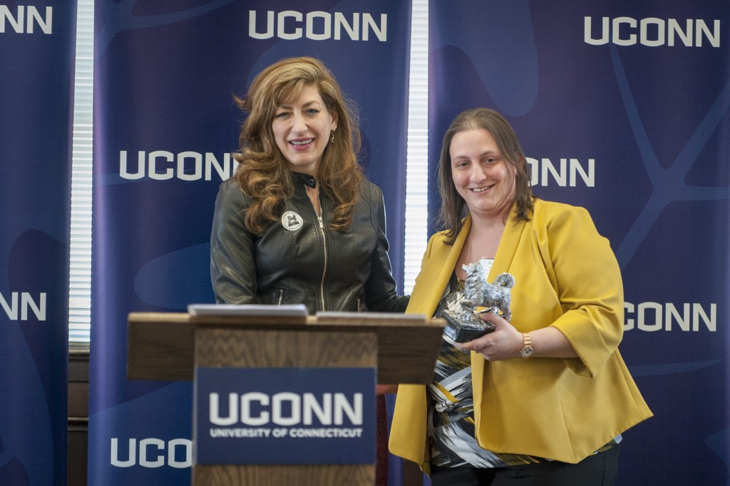 Renee Boggis of Human Resources receives the Unsung Hero Award at the UConn Spirit Awards ceremony on March 8, 2016. (Sean Flynn/UConn Photo)