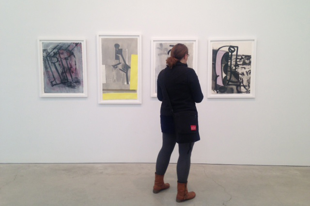 MFA candidate Erin Smith views works on display at the Volta Show on Pier 90 during Armory Arts Week in New York City. (Photo courtesy of students in ART 5310 Graduate Seminar)
