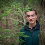 Nicholas Russo '18 (CLAS) checks hemlock trees in the Moss Tract of the UConn Forest in Willington for woolly adelgid sacs on May 6, 2016. (Peter Morenus/UConn Photo)