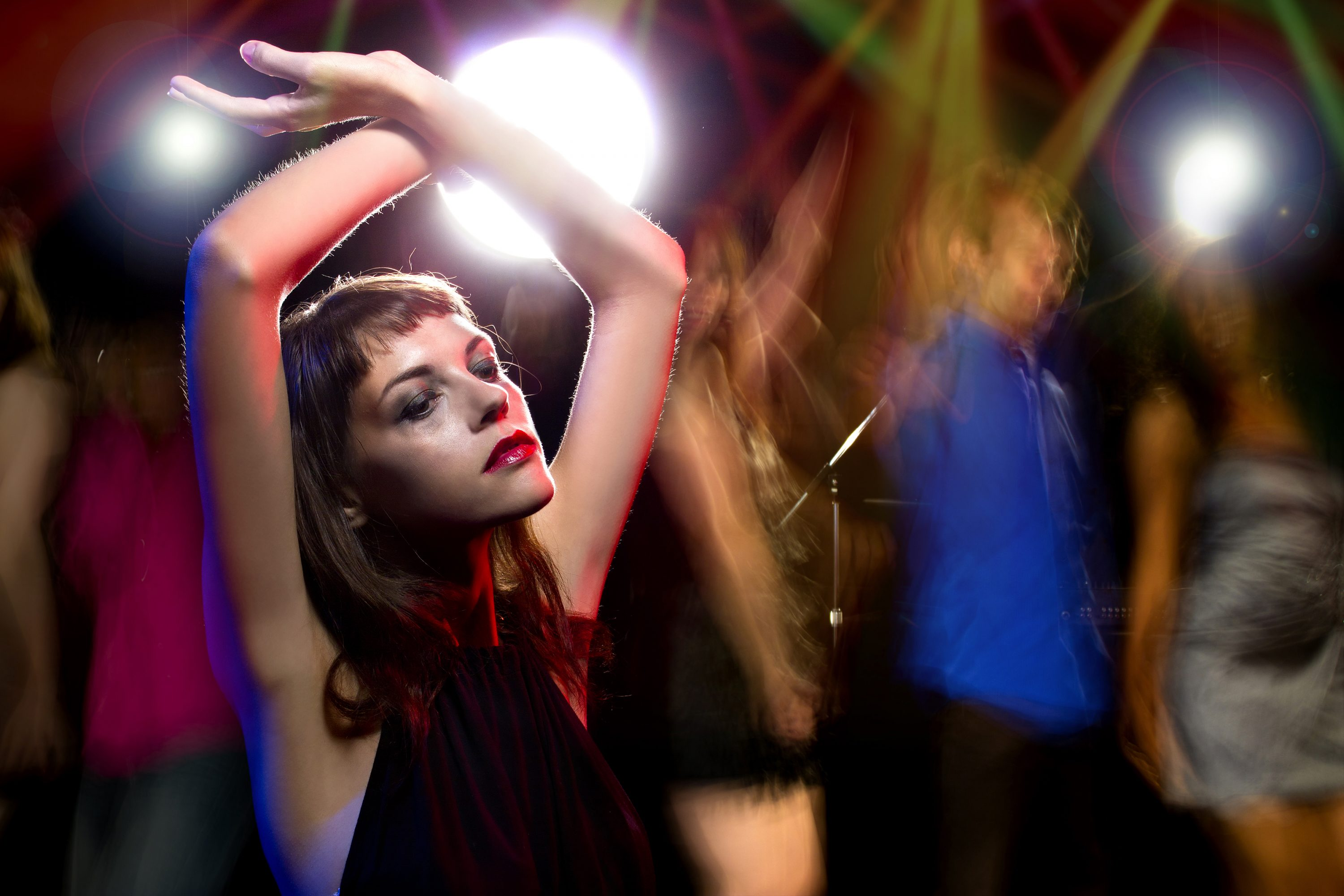 Photo of an intoxicated female dancing at a nightclub and high on drugs or drunk on alcohol. Her make up is smeared like a junkie. She is either a drug addict or an alcoholic. (iStock Photo)