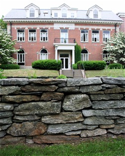 The stone wall surrounding the President's Garden in front of Gulley Hall.