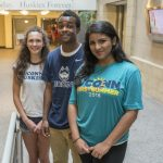 From left, Cyrene Nicholas of Branford, Naaol Shupare of Brooklyn Park, Minn., and Akriti Mishra of West Hartford, members of the Class of 2020. (Sean Flynn/UConn Photo)