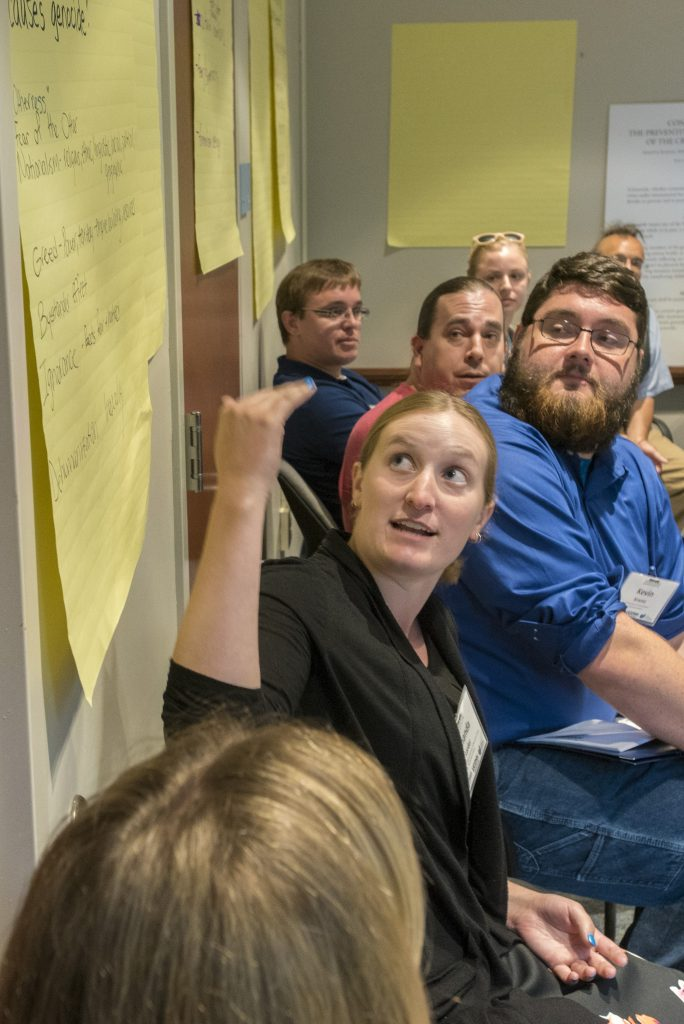 A participant in the 2016 Intellectual Humility in Secondary Education Summer Institute discusses the question, What do you think causes genocide? at the Thomas J. Dodd Research Center on Aug. 1, 2016. (Sean Flynn/UConn Photo)
