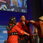 President Obama is presented with a blanket by Mohegan Chief Lynn Malerba, left, and Brian Cladoosby, right, president of the National Congress of American Indians, during the eighth annual White House Tribal Nations Conference. (U.S. Department of the Interior Photo)