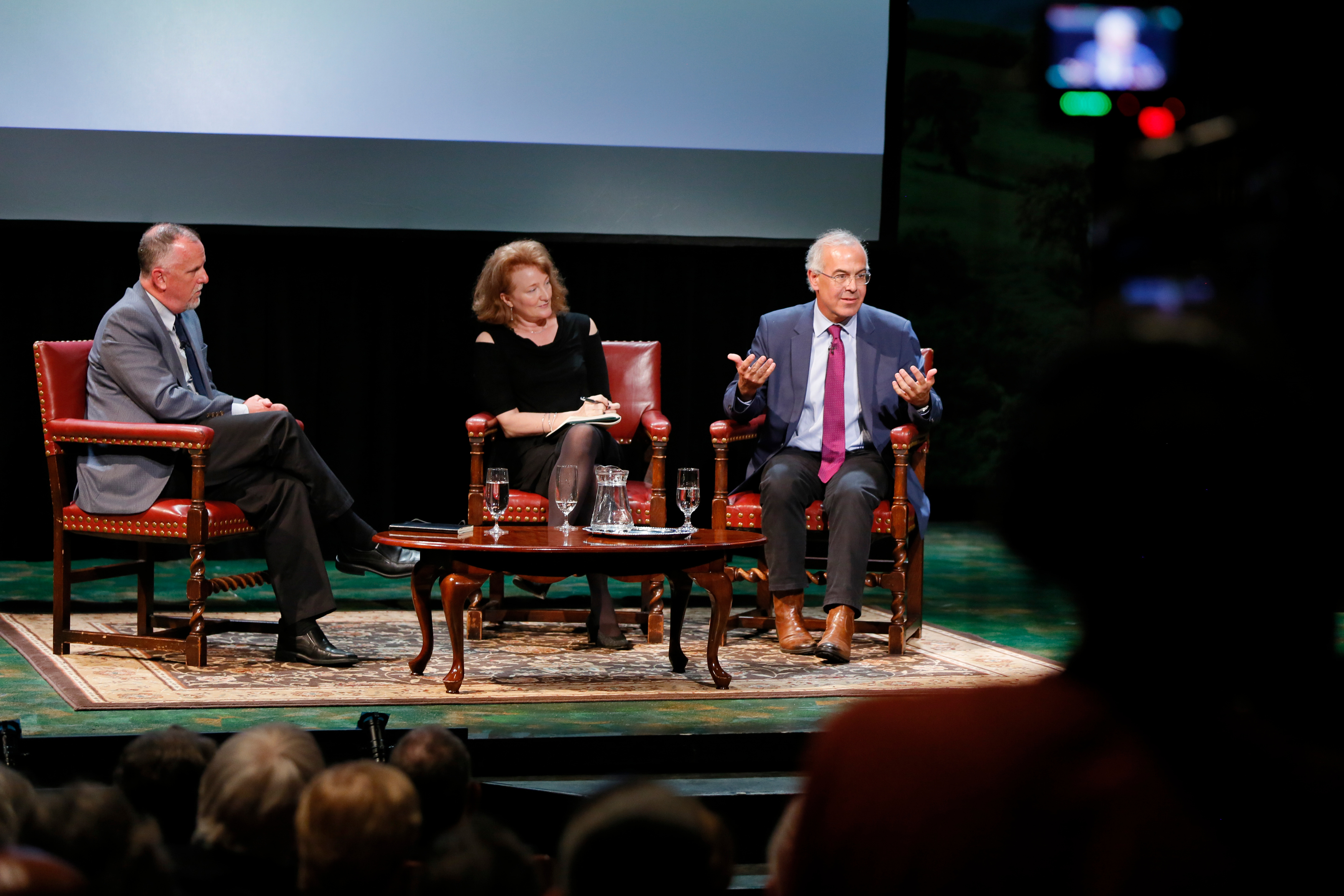 Michael Lynch, left, director of UConn's Humanities Institute, facilitates the panel discussion with Krista Tippet of NPR and David Brooks of the New York Times. (Photo by Garrett Hubbard, GH studios)
