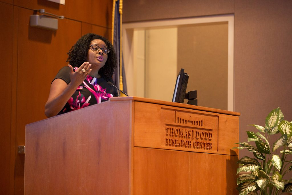 Associate Professor of Political Science and leader of The Collaborative at UConn Shayla Nunnally welcomes participants to the kickoff event for the research initiative on women and girls of color on Sept. 28. Photo by Bri Diaz.