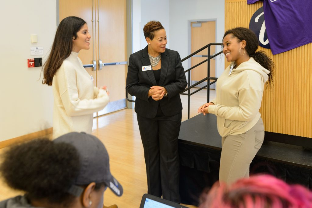 Joelle Murchison speaks with students before a forum on the recent violence seen in Orlando held at the Student Union Ballroom on Oct. 4, 2016. (Peter Morenus/UConn Photo)