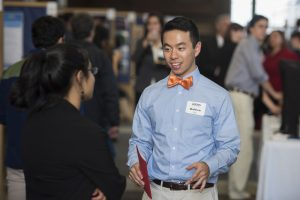 Matthew Lin '18 (CLAS) discusses his research at the Fall Frontiers in Research Poster Exhibition in Wilbur Cross South Reading Room on Oct. 26, 2016. (Ryan Glista '16 (CLAS)/UConn Photo)