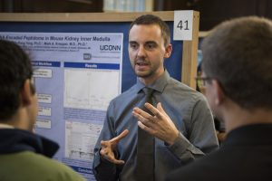 Cameron Flower '17 (ENG) discusses his research at the Fall Frontiers in Research Poster Exhibition in Wilbur Cross South Reading Room on Oct. 26, 2016. (Ryan Glista '16 (CLAS)/UConn Photo)