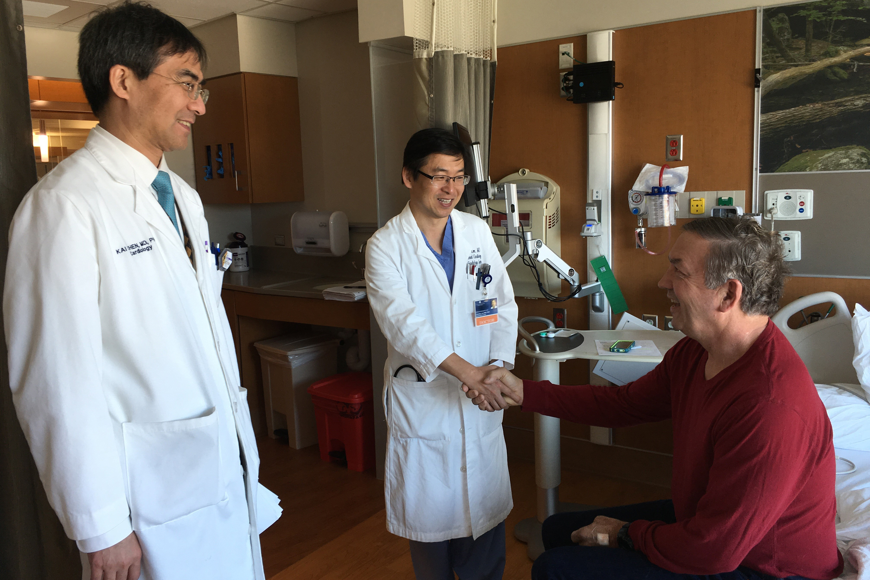 Thanks to prompt treatment by UConn Health team Drs. Kai Chen, left, and Juyong Lee, patient Clyde Livingston gets 'a second chance at life.' (Lauren Woods/UConn Health Photo)