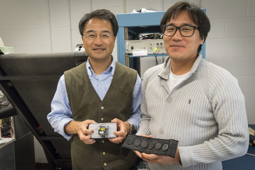 At left Ki Chon, department chair of biomedical engineering, and graduate assistant Yeon Noh, have developed a device that can monitor for an irregular heartbeat for months. (Sean Flynn/UConn Photo)